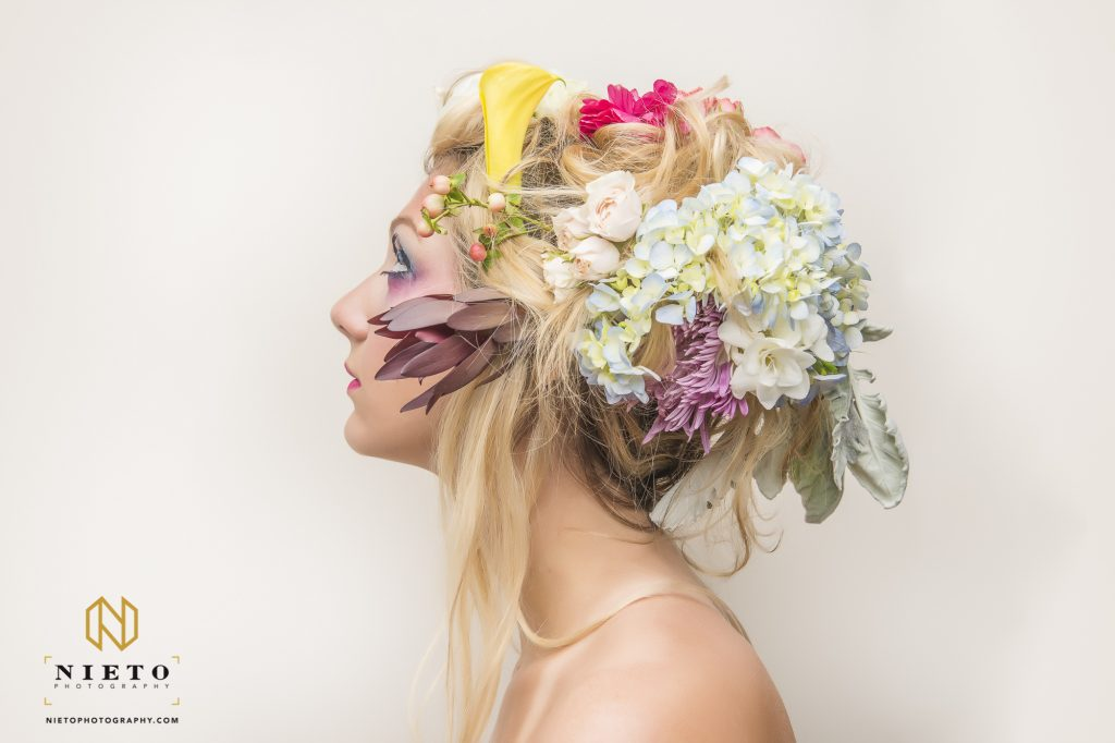 profile shot of model with flowers in her hair
