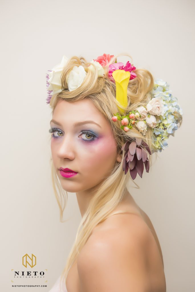 model with bright make up and flowers in her hair