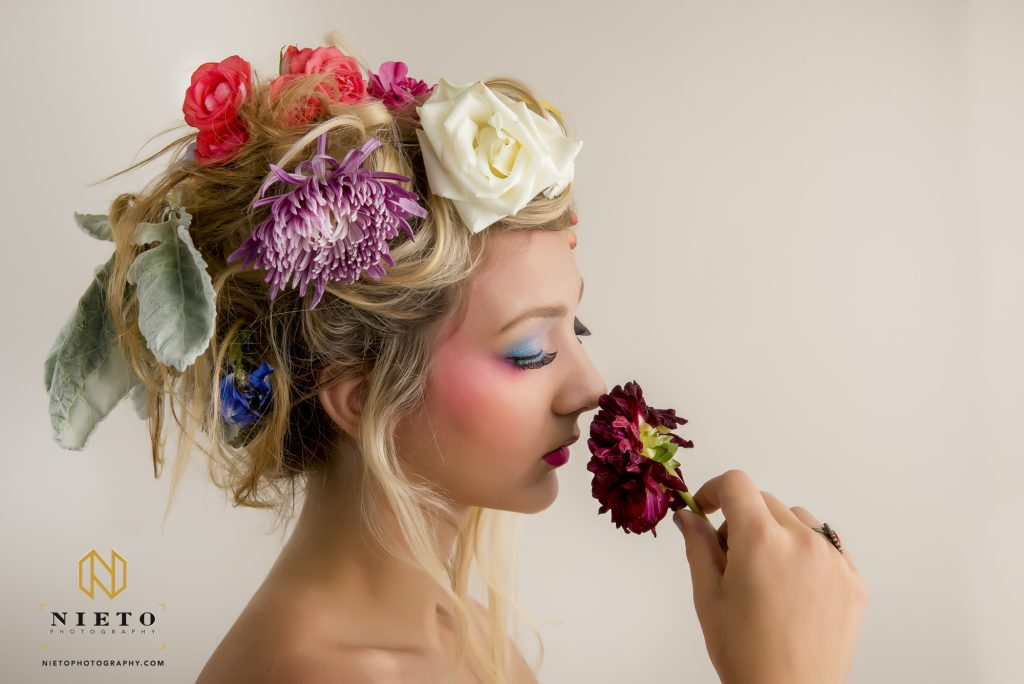 model smelling flower with eyes closed