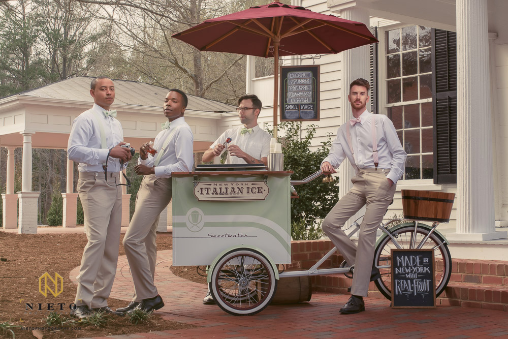 groom and groomsmen posing around italian ice vendor at the Mims house in Holly Springs