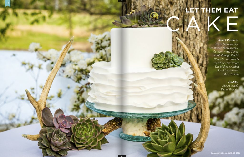 Screen shot of wedding cake outdoors on a table with antlers