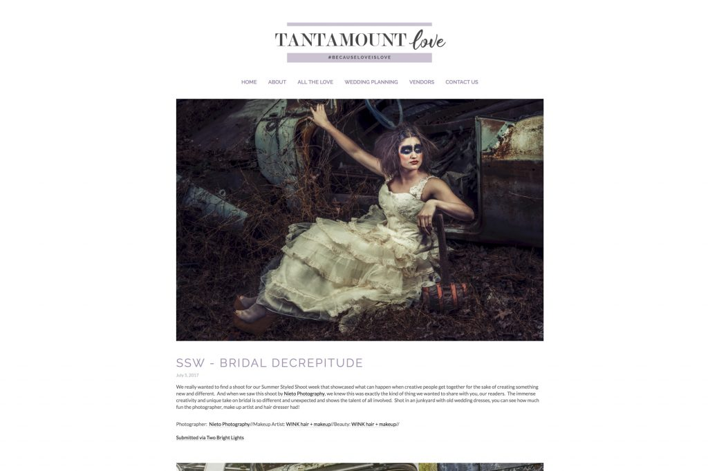 Model in wedding gown in a junk yard with high fashion makeup