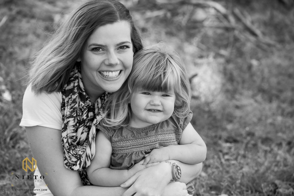 black and white photo of mother and daughter smiling