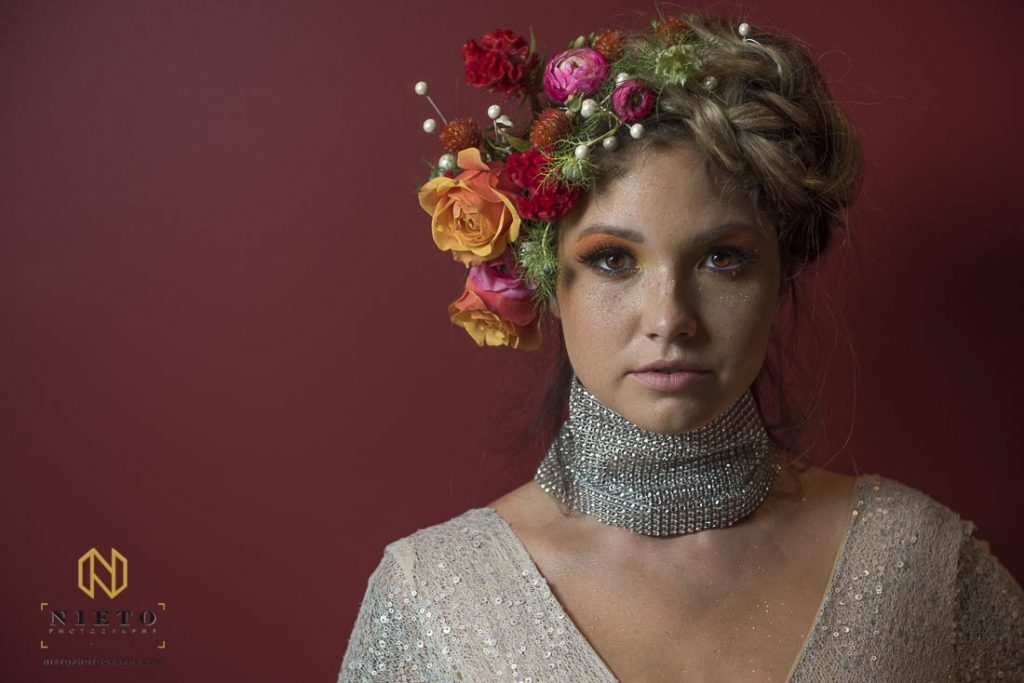Model with flowers and pearls in her hair at Vidrio in Raleigh NC