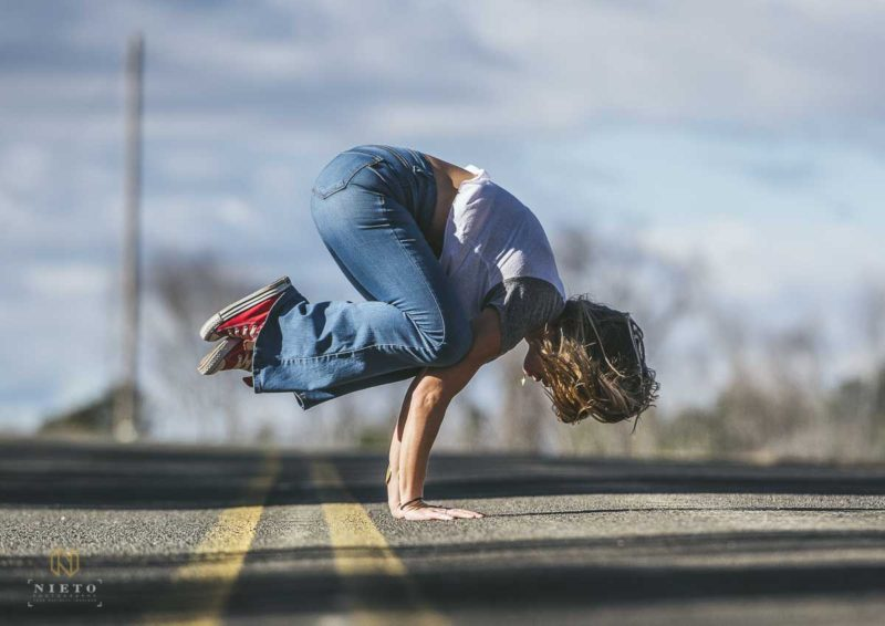 Jenny Yarborough of White Rabbit Trips in Parsva Bakasana pose