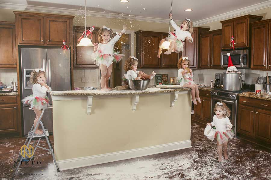 Little girl destroys kitchen for Christmas photo