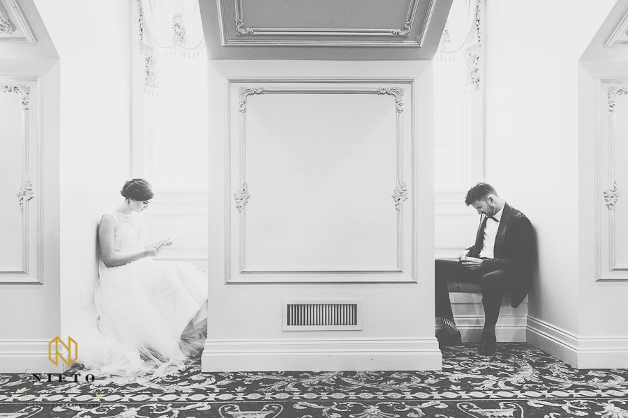 bride and groom reading letters to each other while not seeing each other
