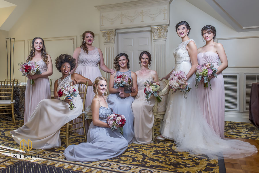 Bridal party posing indoor at the landmark