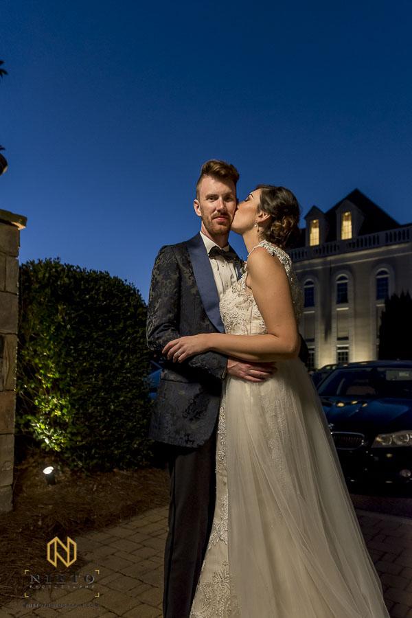 bride kissing her groom at dusk at the Landmark