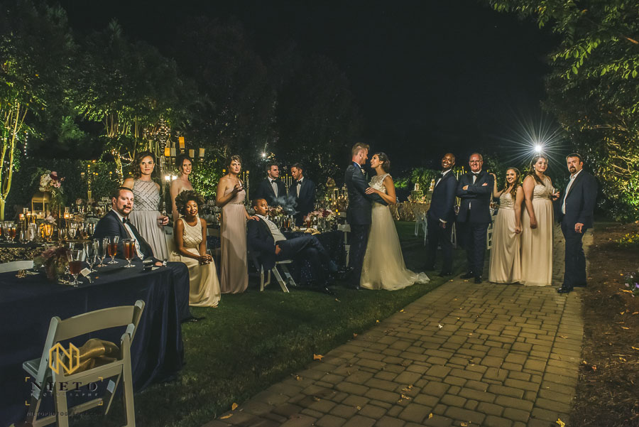 group portrait of the wedding party at in the garden at the Landmark