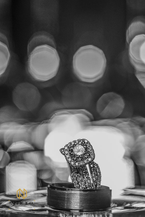 black and white picture of the bride and grooms rings