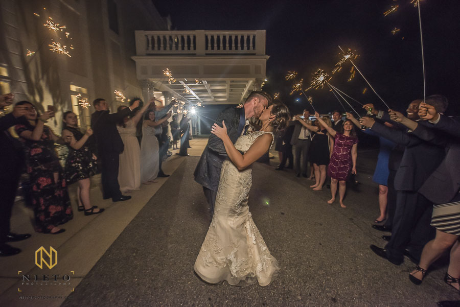 bride and groom kissing during the sparkler exit