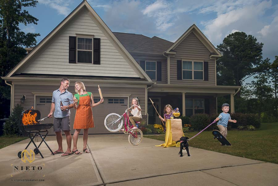 stereotypical American family portrait in front yard of family house