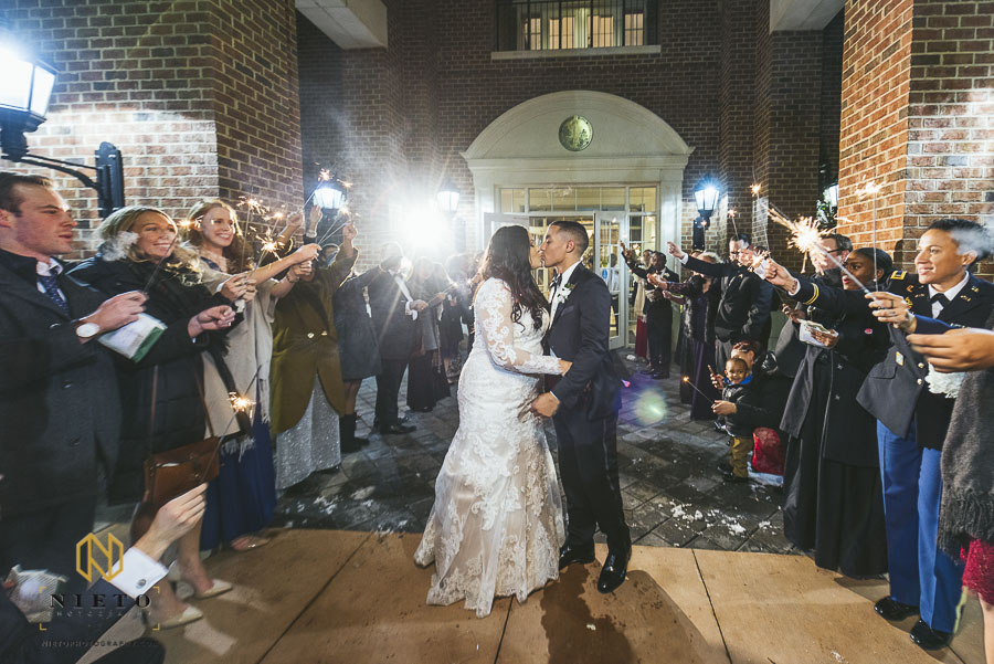 bride and groom kissing during sparkler exit at Park Alumni Center