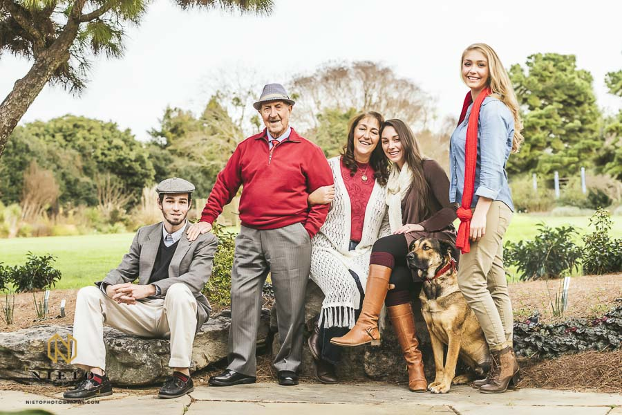 Family poses with grandfather and dog at JC Raulston Arboretum