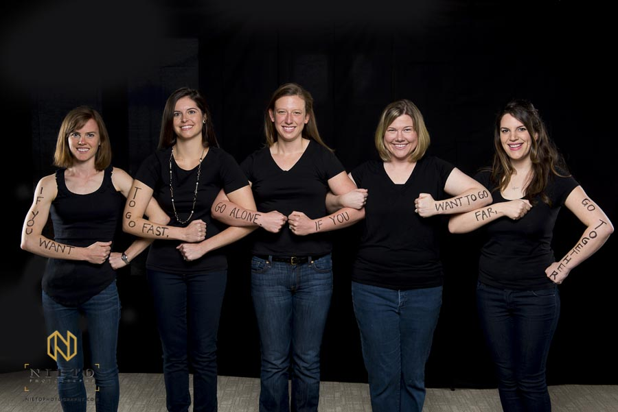 Duke Fuqua students pose for portrait while linking arms