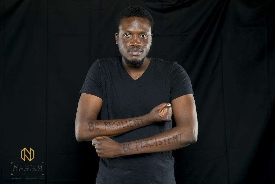 Duke Fuqua MBA student poses for portrait while flexing