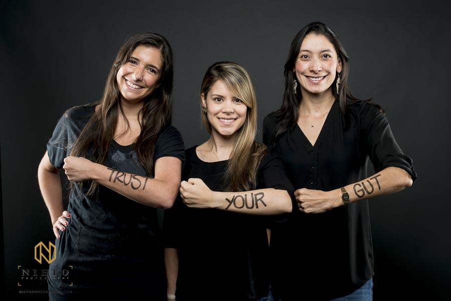 three Duke Fuqua MBA students pose for portrait