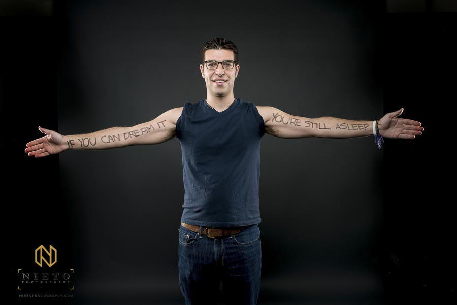 Duke Fuqua Student holding his arms out posing for portrait