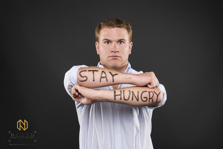 Fuqua Reflects portrait of man with stay hungry written on his arms