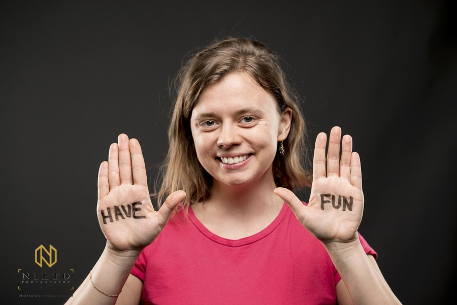 woman holding up her hands with the words Have Fun on them