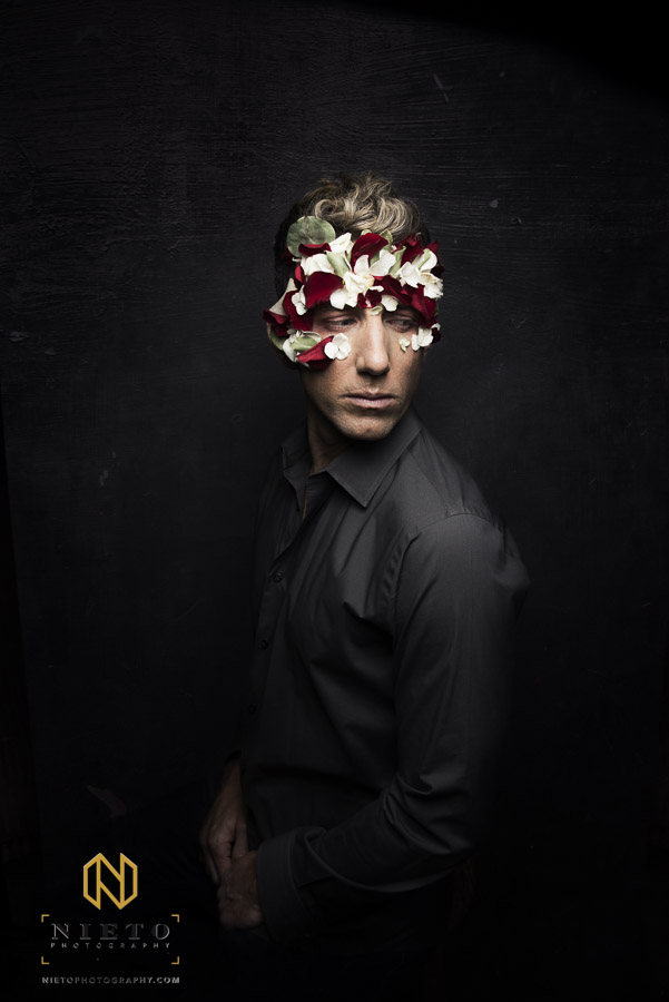 Male model with flowers on his face