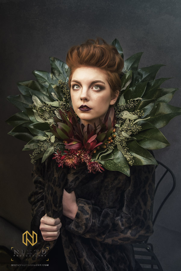 model with red hair and leaf collar