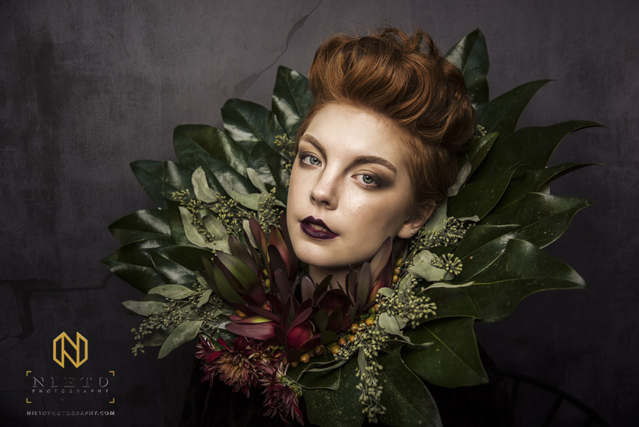 red headed model with huge flower collar for art in bloom project