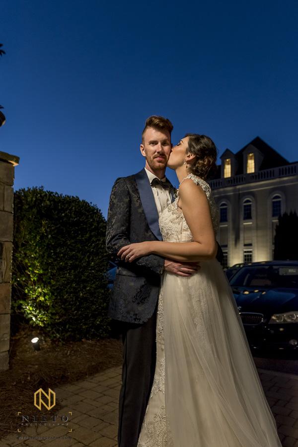 Bride kissing the groom at night at the Landmark in Garner NC