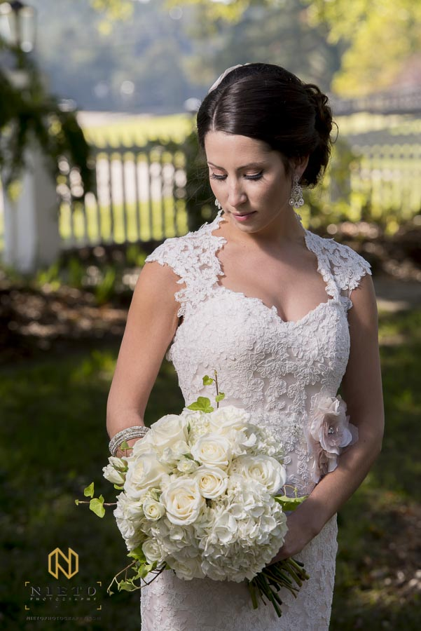 bride holding her bouquet while posing for her bridal portraits at Lake O' the Woods Plantation