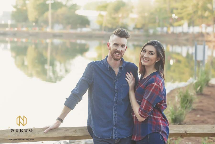 couple posing for engagement portrait at the NC State Fair