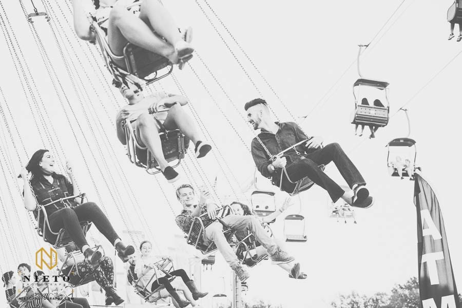 black and white picture of couple riding the swings at the NC State Fair