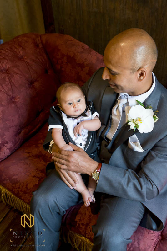 overhead shot of the groom hold his son
