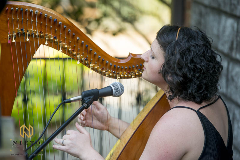 Eryn Jones playing the Harp and singing during a wedding ceremony at Barclay Villa