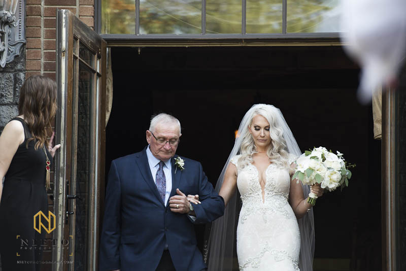 father of the bride escorting his daughter out of Barclay Villa to the wedding ceremony