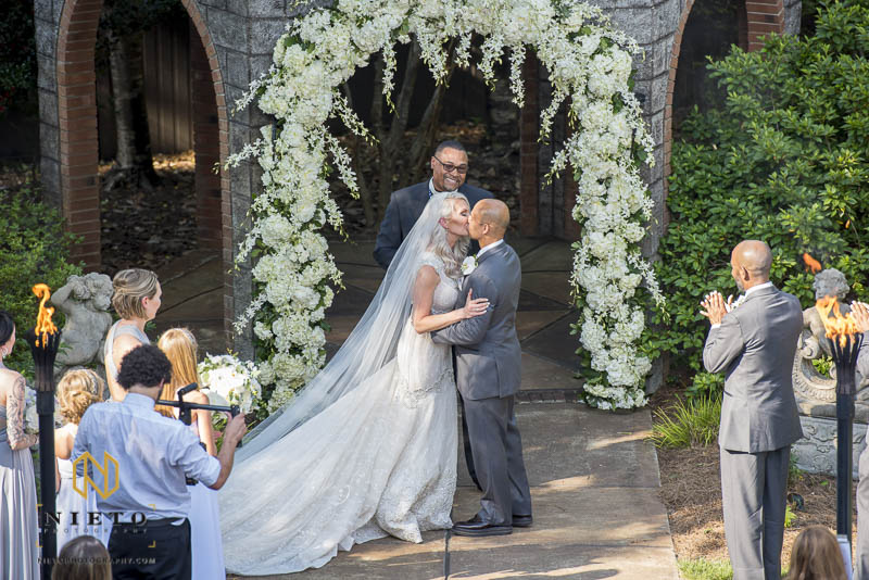 bride and groom kissing for the first time at Barclay Villa