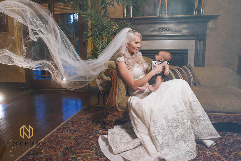 bride poses with her infant son inside barclay villa