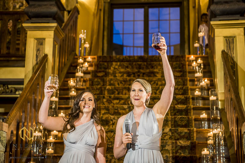 brides maids raising their glasses after giving a great toast