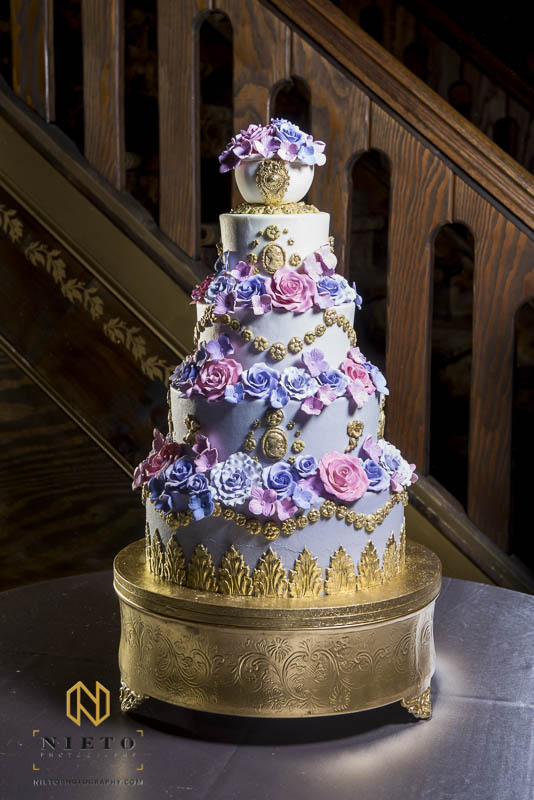 A beautiful gilded wedding cake by Cinda's Cakes at Barclay Villa