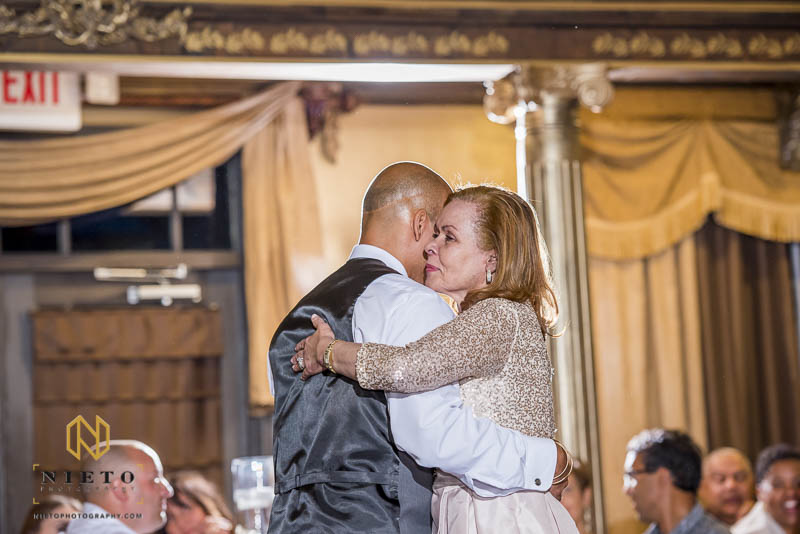 mother hugging the groom during their dance at Barclay Villa
