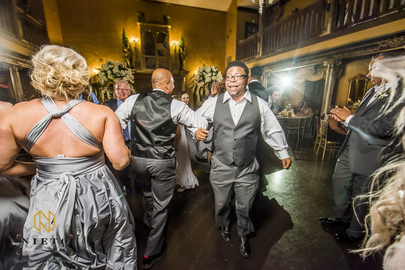 groom and groomsman dancing together on the dance floor at Barclay Villa