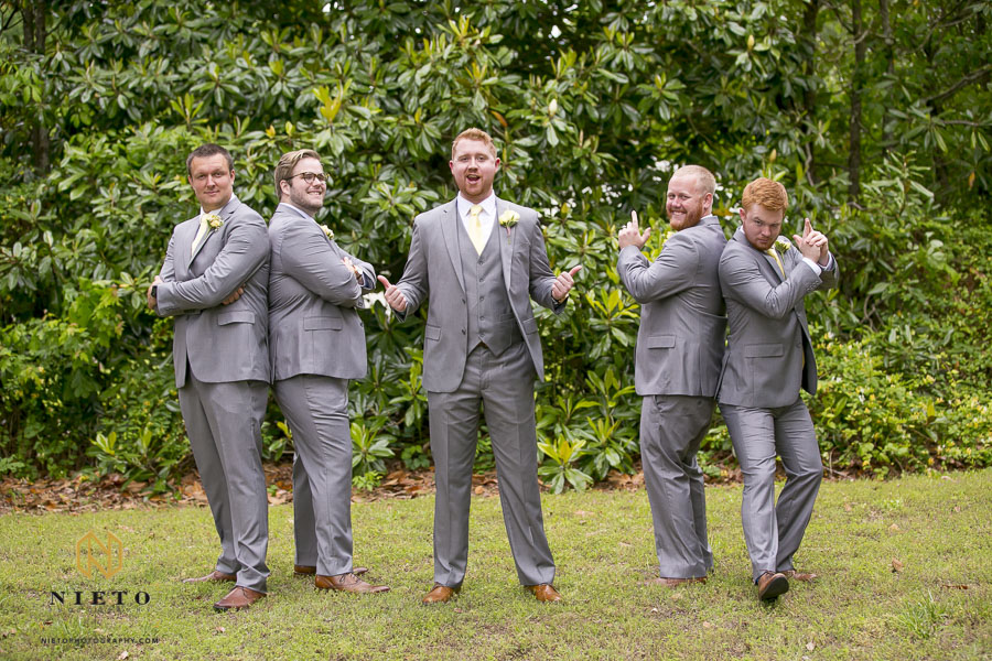 groom and groomsmen posing for fun portrait at the Hudson Manor