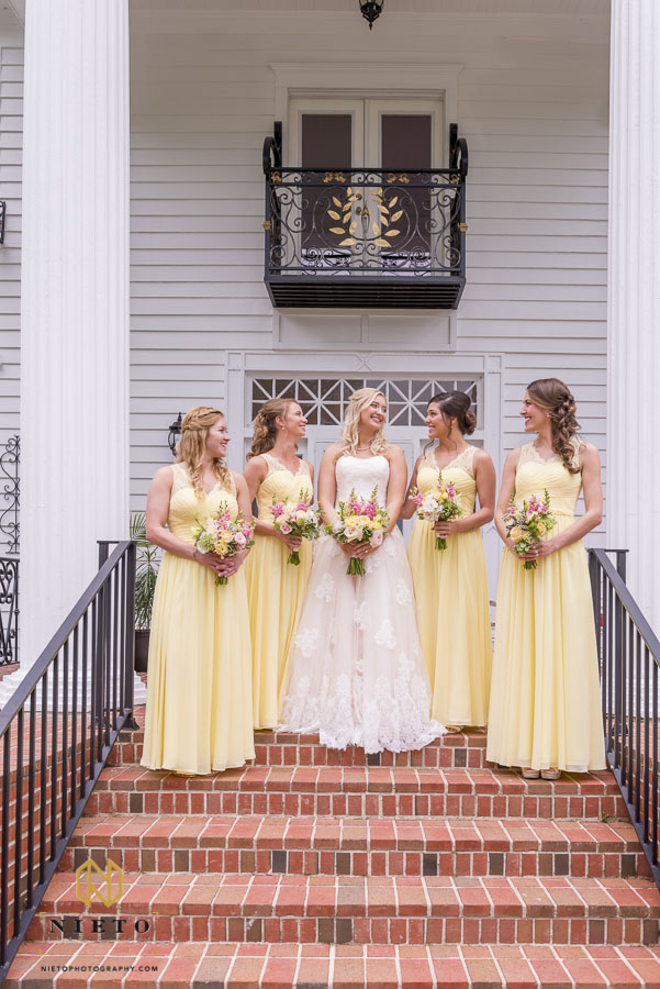 Bride and bridesmaids on the front steps of the Hudson Manor