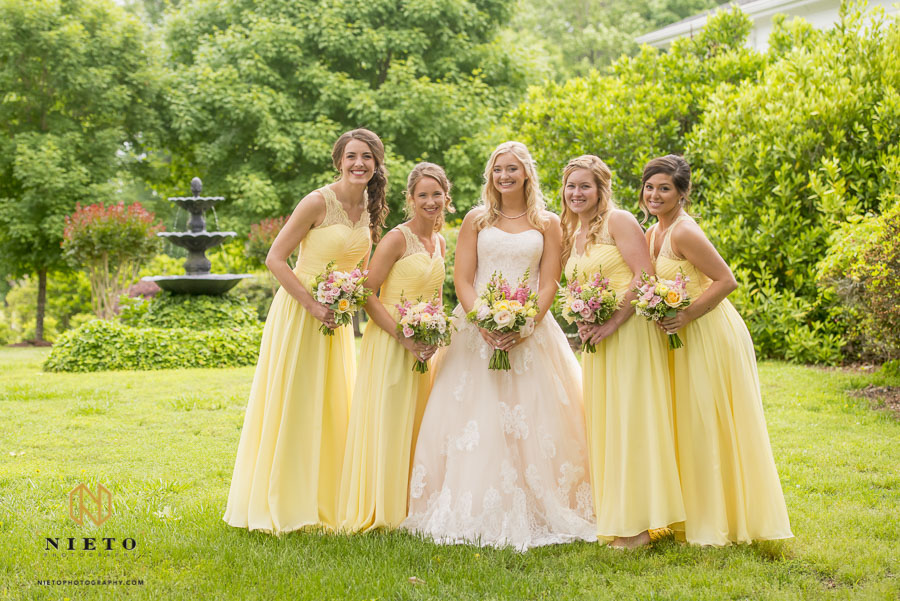 Bride and bridesmaids on the side lawn of the Hudson Manor