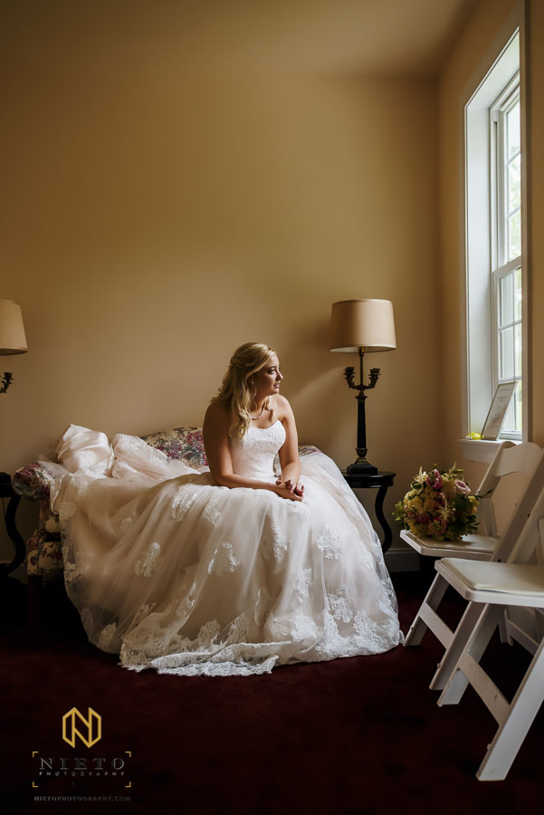 color portrait of bride waiting for her party to meet her at the Hudson Manor