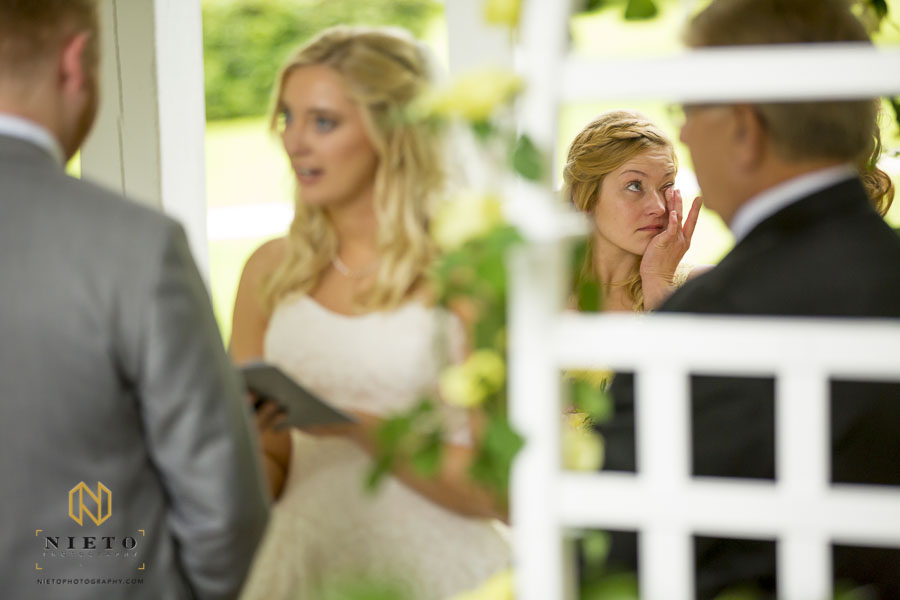 bridesmaid wiping away tears as the bride gives her vows at the Hudson Manor