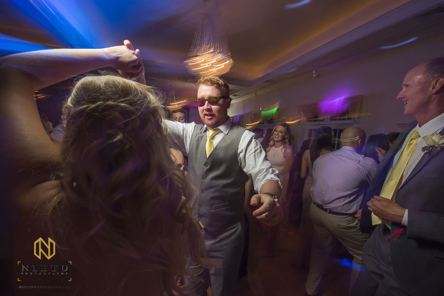 groom dancing at the his reception with sunglasses on at the Hudson Manor