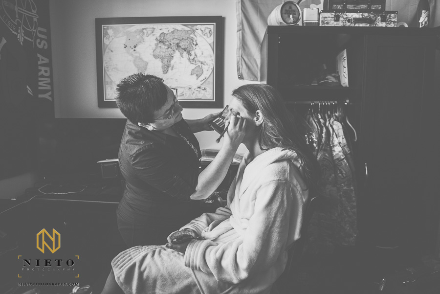 Black and white image of the make up artist working on the brides makeup