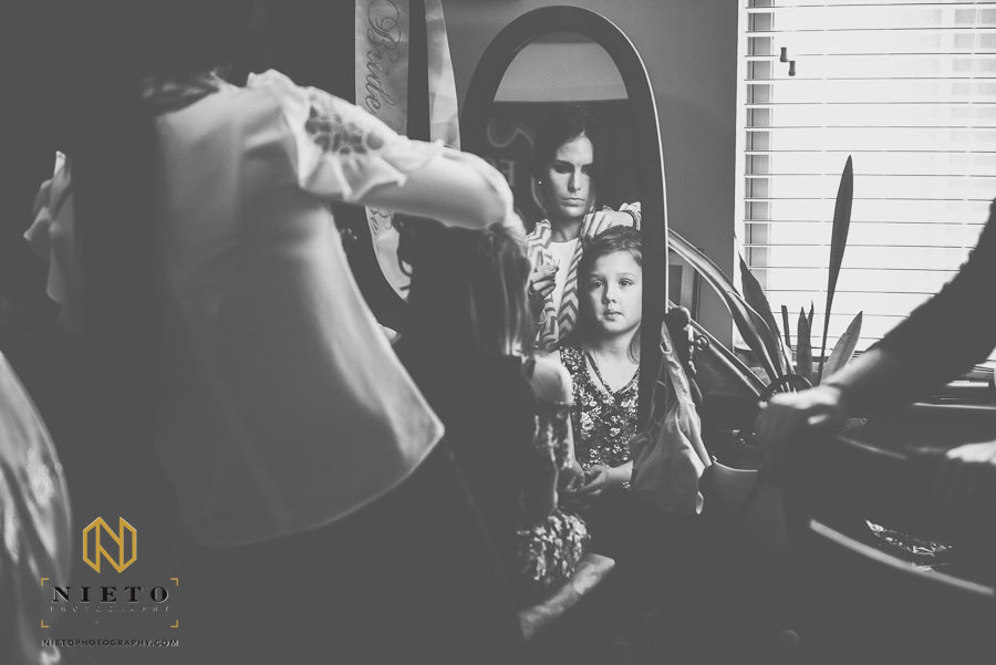 black and white image of flower girl having her hair fixed