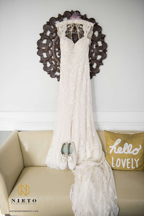 wedding dress hanging over the couch in the bridal suite at Market Hall